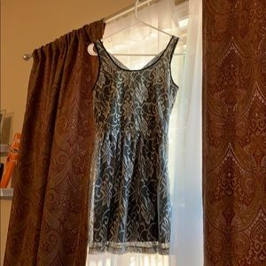 Lace overlay dress, with criss cross back